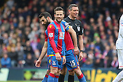 Yohan Cabaye (7) of Crystal Palace and Referee Andre Marriner  during the Barclays Premier League match between Crystal Palace and Liverpool at Selhurst Park, London, England on 6 March 2016. Photo by Phil Duncan.
