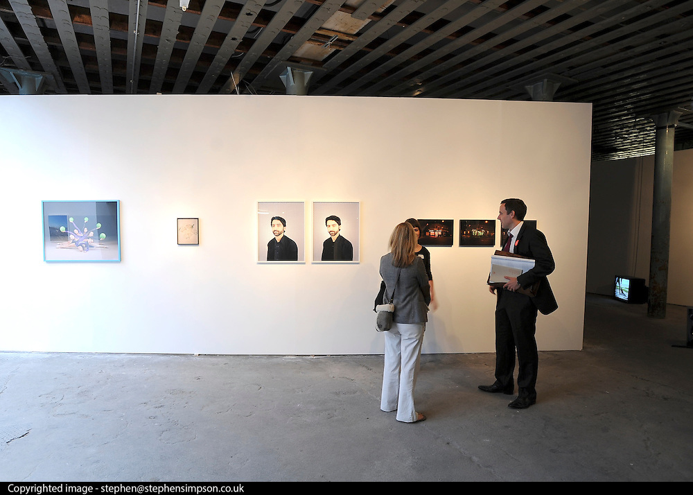 © licensed to London News Pictures. LONDON, UK.  22/06/11. A view into one of the gallery spaces at the RCA graduate show, Battersea, London. Students present their work at The Royal College of Art's Fine Art Graduate Show 2011. The show runs from 24th June-3rd July 2011. Mandatory Credit Stephen Simpson/LNP