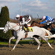 Dawn Commander and Brendan Powell winning the 3.00 race