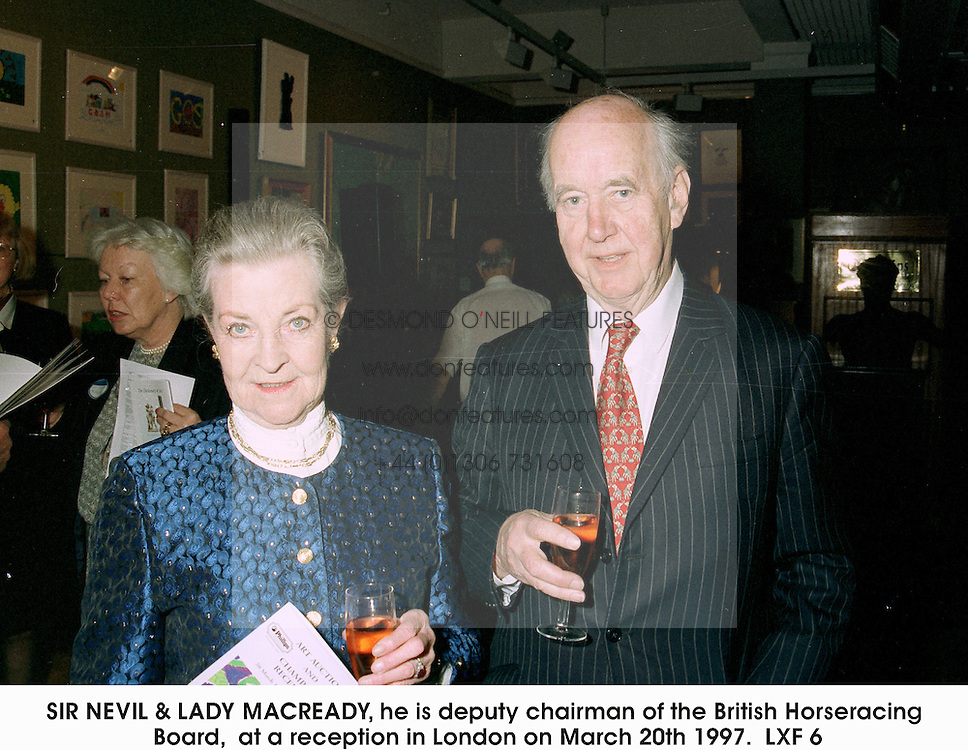 SIR NEVIL & LADY MACREADY, he is deputy chairman of the British Horseracing Board,  at a reception in London on March 20th 1997.LXF 6