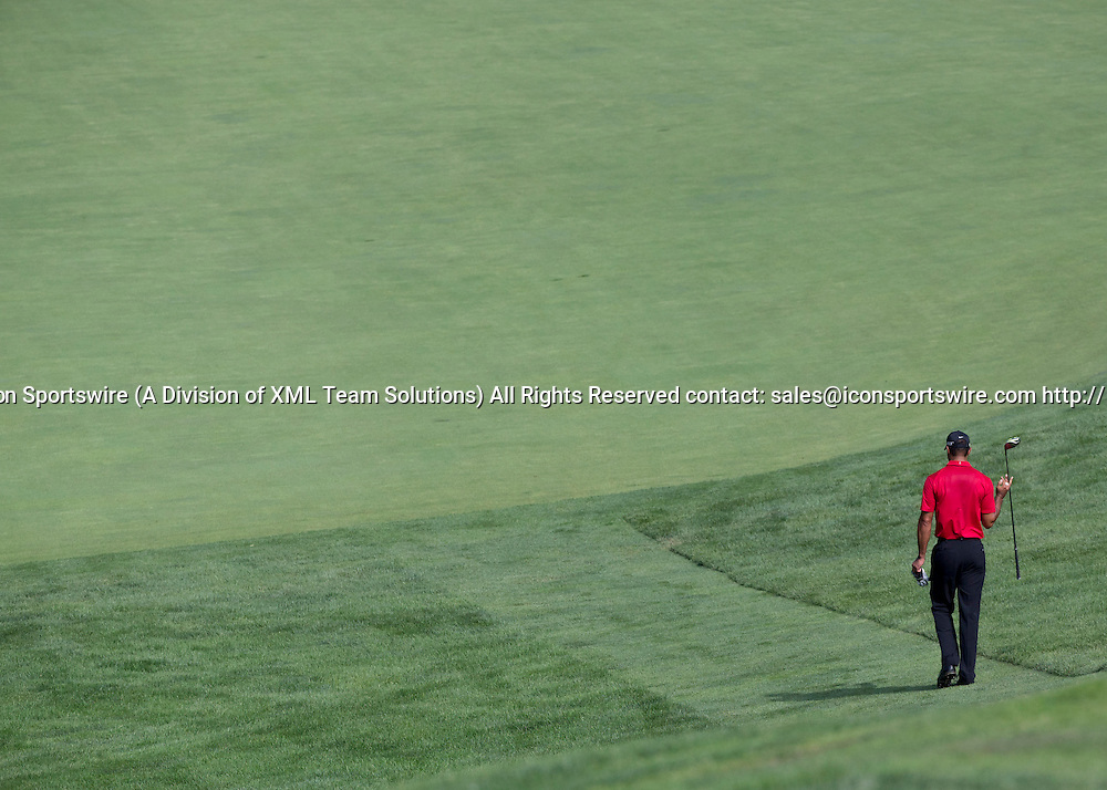June 07 2015: Tiger Woods walking down the hill to the fairway of the 11th tee during the final round of the Memorial Tournament held at the Muirfield Village Golf Club in Dublin, Ohio.