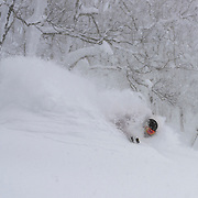 Charlie Cohn gets deep at Rusutsu, Japan.