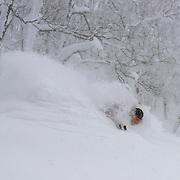 Charlie Cohn gets deep at Rusutsu, Japan.