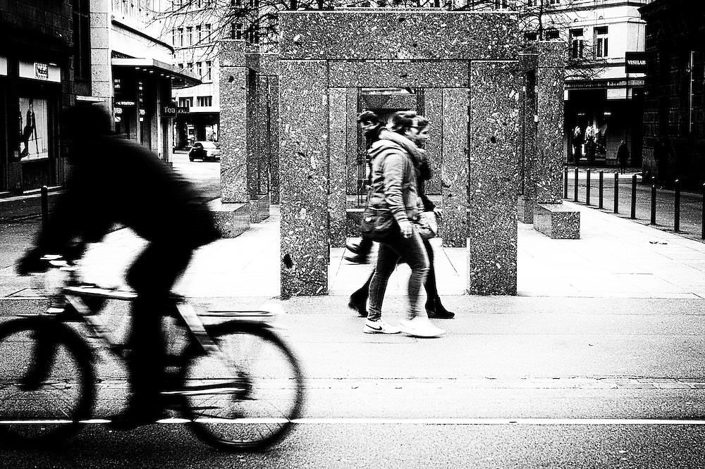 Main Street Zurich at Christmas walkers and cyclist.