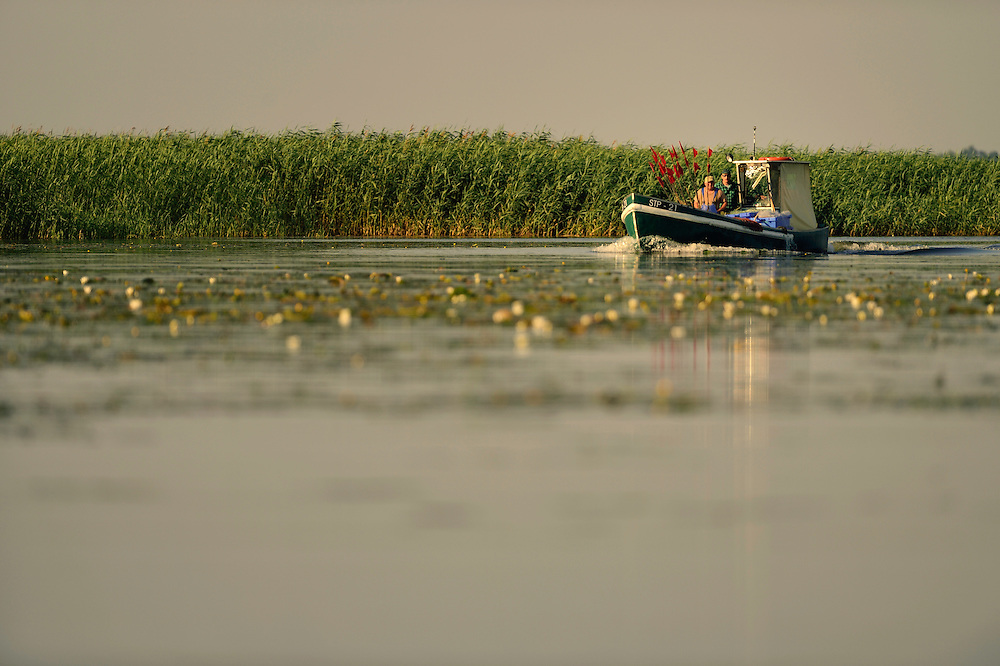 fishermen on the Polish side in the Stettiner Haff lagoon, Stepnica, Poland