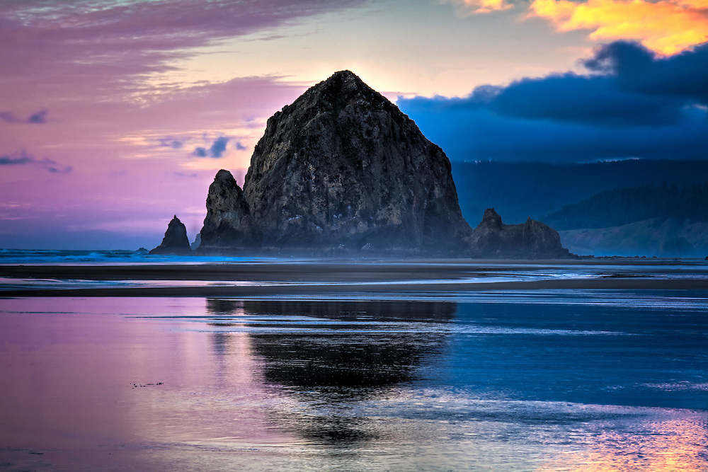 This massive rock on Oregon's Cannon Beach is one of the world's biggest sea stacks. This one was photographed just at the perfect moment of low tide, sunset and as a storm was coming in at full speed!