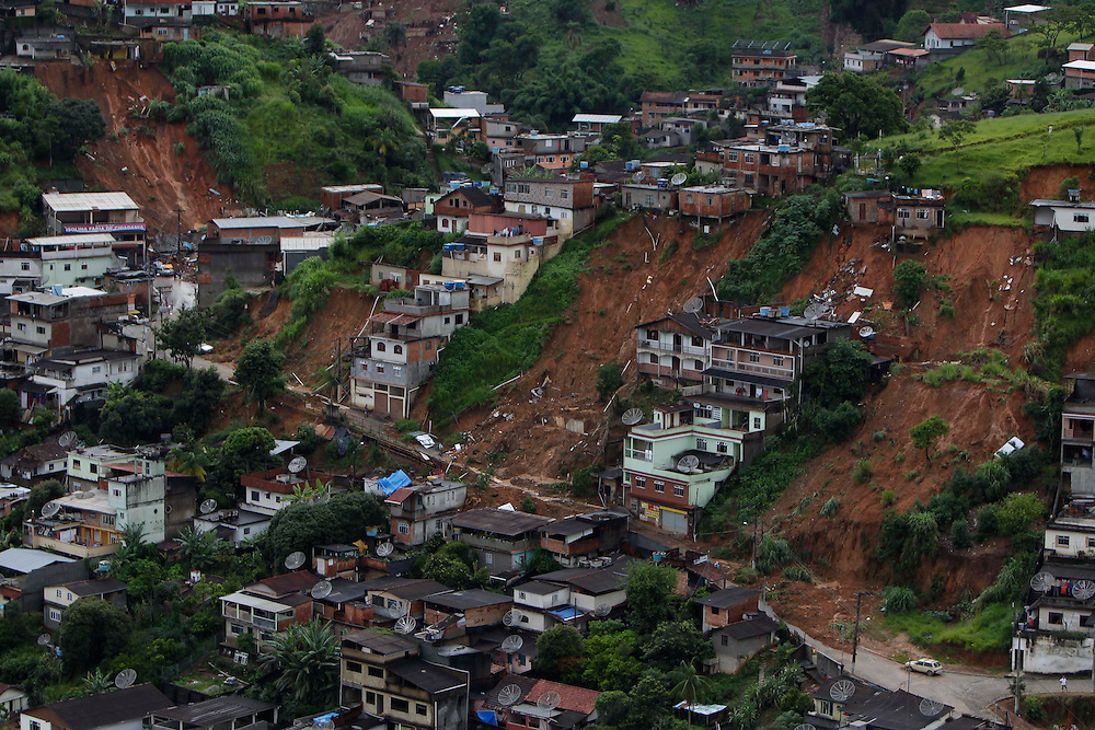Aerial view of houses damaged by landslides in Nova Friburgo, Brazil, Sunday, Jan. 16, 2011.<br /> <br /> A series of flash floods and mudslides struck several cities in Rio de Janeiro State, destroying houses, roads and more. More than 900 people are reported to have been killed and over 300 remain missing in this, Brazil&rsquo;s worst-ever natural disaster.