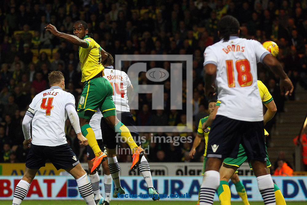 Cameron Jerome of Norwich scores his sides 2nd goal and celebrates during the Sky Bet Championship match at Carrow Road, Norwich<br /> Picture by Paul Chesterton/Focus Images Ltd +44 7904 640267<br /> 31/10/2014