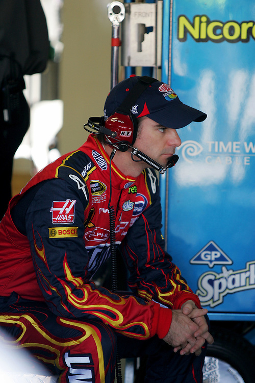 September 26, 2008; Kansas City, KS, USA; Jeff Gordon waits for minor adjustments to his car during practice for the Camping World RV 400 at Kansas Speedway. Mandatory Credit: Douglas Jones-DDJ Sports Imaging
