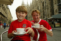 MILAN, ITALY - Friday, September 5, 2003: Wales fans, father and son Tim and Rees Hartley, enjoy a cappuccino in front of the cathedral in Milan. (Pic by David Rawcliffe/Propaganda)