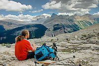 Hiker resting and taking in views from the Iceline Trail, Yoho National Park British Columbia Canada