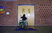Riley Ljungdahl, 12, waits for Amanda Ward (not pictured) to open the gymnasium doors so she can get to an elevator to get to class, Thursday, May 2, 2013, at St. John the Baptist School in Longmont.<br /> (Matthew Jonas/Times-Call)