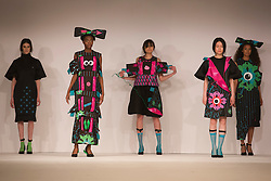 © Licensed to London News Pictures. 31/05/2014. London, England. Collection by Lisa Berry from Edinburgh College of Art. Graduate Fashion Week 2014, Runway Show at the Old Truman Brewery in London, United Kingdom. Photo credit: Bettina Strenske/LNP