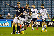 Martyn Woolford of Millwall and Robert Hall of Bolton Wanderers during the Sky Bet Championship match at The Den, London<br /> Picture by David Horn/Focus Images Ltd +44 7545 970036<br /> 19/12/2014