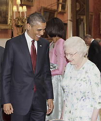 Britain's Queen Elizabeth II, shows U.S. President Barack Obama, American items from The Royal Collection in the Picture Gallery of Buckingham Palace during his state visit to the UK and Ireland.