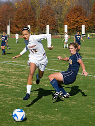 Virginia Cavaliers forward Jess Rostedt (12) dribbles past a WVU defender.  The #16 ranked Virginia Cavaliers defeated the #12 ranked West Virginia Mountaineers 3-2 in the second round of NCAA Division 1 Women's Soccer Tournament at Klockner Stadium on the Grounds of the University of Virginia in Charlottesville, VA on November 16, 2008.