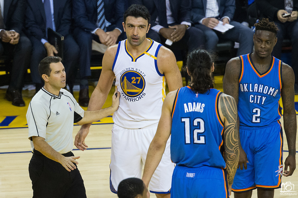 Golden State Warriors center Zaza Pachulia (27) reacts to a foul by Oklahoma City Thunder center Steven Adams (12) at Oracle Arena in Oakland, Calif., on November 3, 2016. (Stan Olszewski/Special to S.F. Examiner)