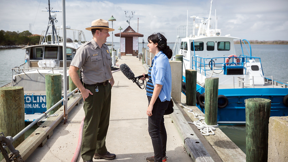 COCKSPUR ISLAND, GA. - FEBRUARY 21, 2018: National Park Service Fort Pulaski National Monument Chief of Interpretations Joel Cadoff and WABE intrepid reporter Molly Samuel talk about the effects of climate change on historic sites. (WABE Photo/Stephen B. Morton)