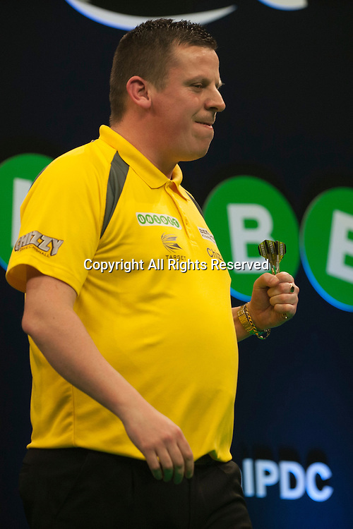31.01.2016. ArenaMK, Milton Keynes, England. Unibet Masters Darts Championship.  Dave Chisnall [ENG] in action during his semi final match against James Wade [ENG]. Dave Chisnall [ENG] won the match 11-6. p.
