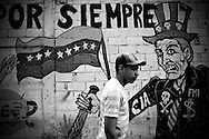 A mural in the slum of El Junquito, a slum on the outskirts of Caracas, Venezuela. The Venezuelan government commissions collectives of graffiti artists to plaster the city in murals and stencils that promote the Bolivarian revolution and the political agenda of President Hugo Chavez.