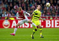 17/09/15 UEFA EUROPA LEAGUE GROUP STAGE<br /> AJAX v CELTIC<br /> AMSTERDAM ARENA - HOLLAND<br /> Celtic's Stefan Johansen (right) battles with Daley Sinkgraven
