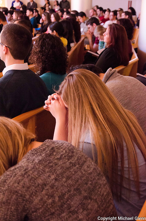 Jan. 25, 2014 Piscataway USA // Young woman bows her head during afternoon prayer at the New Jersey Catholic Young Adult Conference