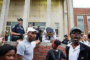 Baltimore, Maryland - April 20, 2015: Baltimore Police Lt. Col. Melvin T. Russell listens to and addresses demonstrators gathered outside the Western District Police Station in Baltimore Monday to protest the death of Freddie Gray.<br /> <br /> <br /> CREDIT: Matt Roth for The New York Times<br /> Assignment ID: 30173608A