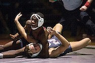 NIC freshman 141 pound Terrance McKinney pins Northwest's Zac Loveless one handed in the final seconds of their fourth round Friday night.