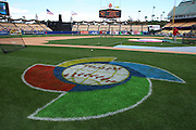 LOS ANGELES, CA - MARCH 22: The WBC logo is painted on the grass in the foreground as team USA takes batting practice before playing against Japan in game two of the semifinal round of the 2009 World Baseball Classic at Dodger Stadium in Los Angeles, California on Sunday March 22, 2009. Japan defeated USA 9-4. (Photo by Paul Spinelli/WBCI/MLB Photos)