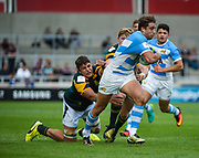 Argentina centre Juan Cruz Mallia breaks through the South African defence during the World Rugby U20 Championship 3rd Place play-off  match Argentina U20 -V- South Africa U20 at The AJ Bell Stadium, Salford, Greater Manchester, England on Saturday, June 25, 2016.(Steve Flynn/Image of Sport)