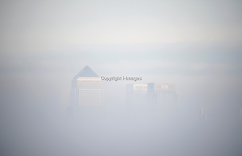 Canary Wharf in London standing out over the  freezing morning fog, London, UK, December 12, 2012. Photo by i-Images.