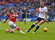 Bristol city Midfielder, Korey Smith looks to sneak one in but cant get past Bolton Goalkeeper, Ben Amos during the Sky Bet Championship match between Bolton Wanderers and Bristol City at the Macron Stadium, Bolton, England on 7 November 2015. Photo by Mark Pollitt.