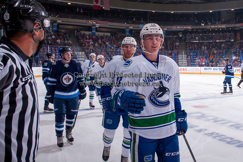 PENTICTON, CANADA - SEPTEMBER 8: Kole Lind #78 of Vancouver Canucks skates to the bench to celebrate a first period goal against the Winnipeg Jets on September 8, 2017 at the South Okanagan Event Centre in Penticton, British Columbia, Canada.  (Photo by Marissa Baecker/Shoot the Breeze)  *** Local Caption ***