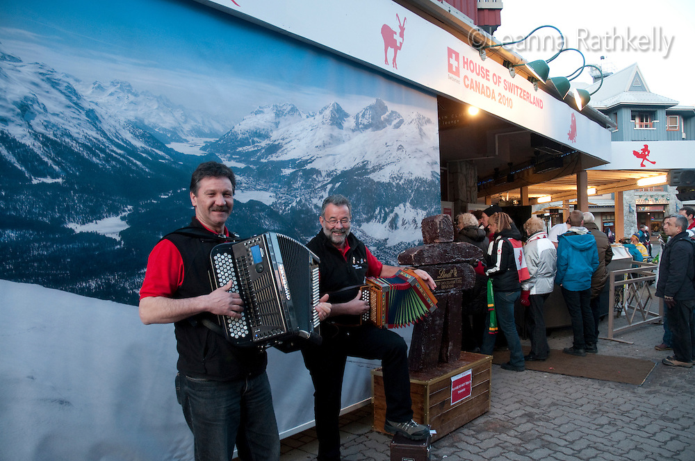 Cort and Felix entertain visitors with traditional Swiss accordian music at the House of Switzerland during the 2010 Olympic Winter Games in Whistler, BC Canada.