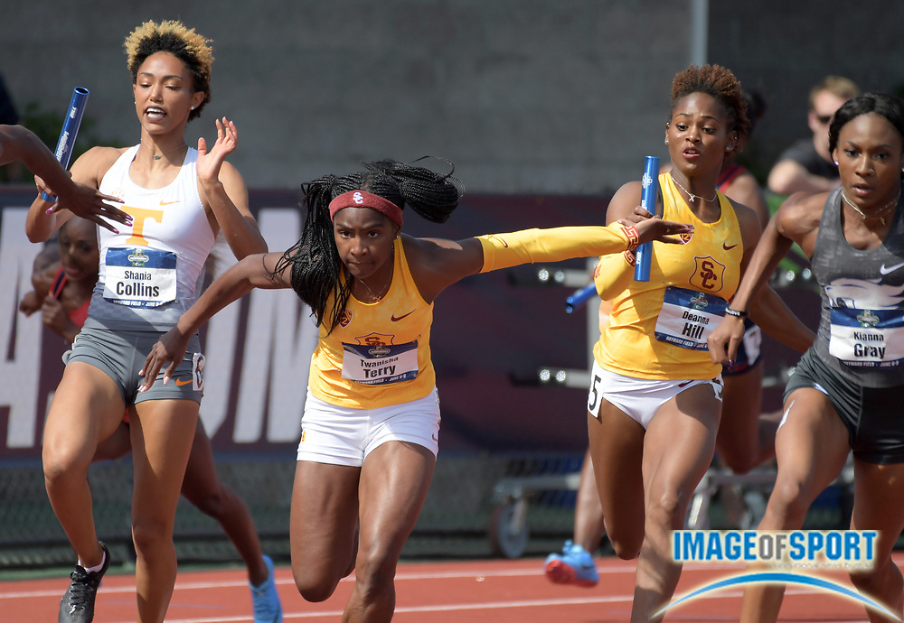 Jun 7, 2018; Eugene, OR, USA; Twanisha Terry takes the handoff from Deanna Hill on the anchor leg of the Southern California Trojans women's 4 x 100m relay that won its heat in 42.97 during the NCAA Track and Field championships at Hayward Field.