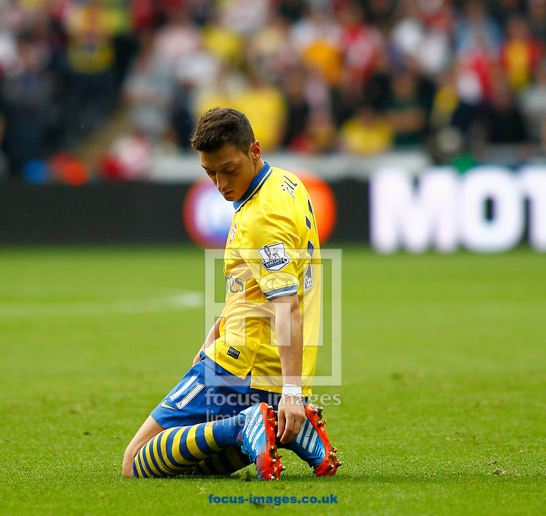 Picture by Mike  Griffiths/Focus Images Ltd +44 7766 223933<br /> 28/09/2013<br /> Mesut Ozil of Arsenal during the Barclays Premier League match at the Liberty Stadium, Swansea.