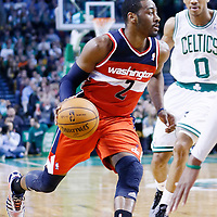 07 April 2013: Washington Wizards point guard John Wall (2) drives past Boston Celtics point guard Avery Bradley (0) during the Boston Celtics 107-96 victory over the Washington Wizards at the TD Garden, Boston, Massachusetts, USA.