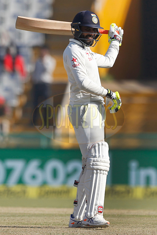 Ravindra Jadeja of India unfurls his trademark bat-twirling celebration scoring half century during day 3 of the third test match between India and England held at the Punjab Cricket Association IS Bindra Stadium, Mohali on the 28th November 2016.<br /> <br /> Photo by: Deepak Malik/ BCCI/ SPORTZPICS
