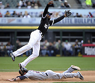 CHICAGO - APRIL 24:  Alexei Ramirez #10 of the Chicago White Sox leaps in the air as Jason Kipnis #22 of the Cleveland Indians steals second base in the sixth inning on April 24, 2013 at U.S. Cellular Field in Chicago, Illinois.  The White Sox defeated the Indians 3-2.  (Photo by Ron Vesely)   Subject: Alexei Ramirez; Jason Kipnis