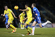 AFC Wimbledon defender Darius Charles (32) and Gillingham FC striker Rory Donnelly (9) during the EFL Sky Bet League 1 match between Gillingham and AFC Wimbledon at the MEMS Priestfield Stadium, Gillingham, England on 21 February 2017.