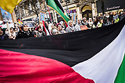 Frankfurt am Main | 16.12.2017<br /> <br /> On Saturday, December 16, 2017 about 1000 men, women and children take part in a demonstration march against the declaration of U.S. president Donald Trump to recognize Jerusalem as the capital of Israel and to relocate the U.S. Embassy in Israel from Tel Aviv to Jerusalem. The demonstration was registered under the slogan &quot;Demo f&uuml;r Jerusalem - Jerusalem/Alkudus ist die Hauptstadt Pal&auml;stinas&quot; (Demo for Jerusalem - Alkudus is the capital of Palestine).<br /> Here: Demonstrators with large palestinian flag.<br /> <br /> photo &copy; peter-juelich.com<br /> <br /> - Foto honorarpflichtig<br /> - No Model Release<br /> - No Property Release
