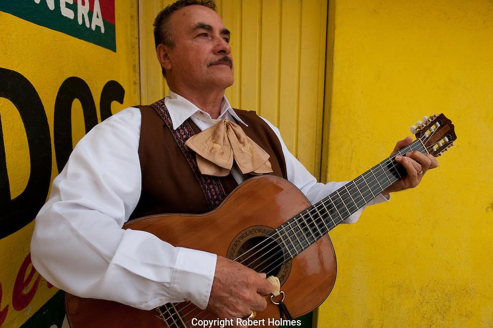 Mariarchi guitarist in Mazatlan, Mexico