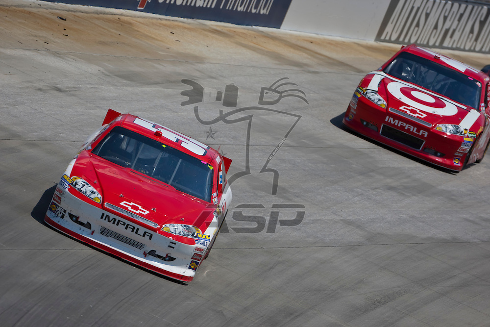 DOVER, DE - JUN 03, 2012:  Kurt Busch (51) races during the FedEx 400 Benefiting Autism Speaks at the Dover International Speedway in Dover, DE.