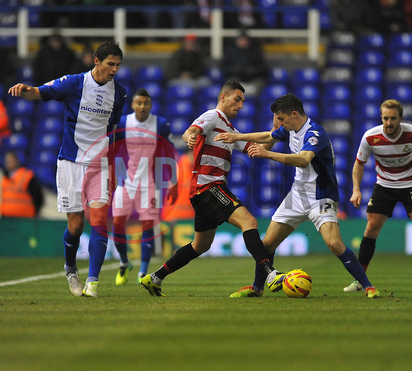 Birmingham City's Callum Reillya battles for the ball with Doncaster Rovers' Federico Macheda - Photo mandatory by-line: Alex James/JMP - Tel: Mobile: 07966 386802 03/12/2013 - SPORT - Football - Birmingham - St Andrews - Birmingham City v Doncaster Rovers - Sky Bet Championship