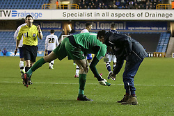 Sheffield Wednesday's Chris Kirkland hands a bottle to a member of the ground staff that was thrown on to the pitch  by angry fans - Photo mandatory by-line: Robin White/JMP - Tel: Mobile: 07966 386802 28/01/2014 - SPORT - FOOTBALL - The Den - Millwall - Millwall v Sheffield Wednesday - Sky Bet Championship