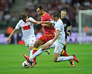 Montenegro's Mirko Vucinic and Grzegorz Krychowiak and Artur Jedrzejczyk of Poland during the FIFA World Cup 2014 group H qualifying football match of Poland vs Montenegro on September 6, 2013 in Warsaw, <br />Photo by: Piotr Hawalej