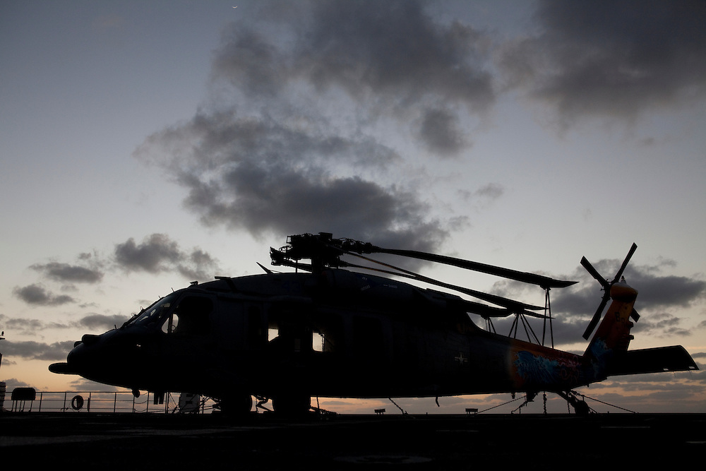 An MH-60S helicopter sits on the flight deck the USNS Comfort, a naval hospital ship, on its way to help survivors of the earthquake in Haiti. The helicopter will be used to transport patients to the ship for medical treatment on Monday, January 18, 2010 in the Atlantic Ocean off the coast of the United States.