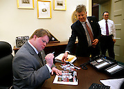 2/12/13 5:49:33 AM -- Washington, DC, U.S.A<br />  -- Teddy Kremer of White Oak signs his autograph to photos of himself as a bat boy for the Cincinnati Reds for David Schnittger, Deputy Chief of Staff for the office of the Speaker of the House prior to President Barack Obama delivering the State of the Union address to a joint session of the United States Congress at the U.S. Capitol. The Enquirer/Jeff Swinger