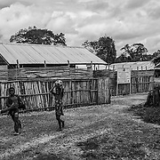 KIds play football by the Community Health Centre, John Logan Town. Liberia.