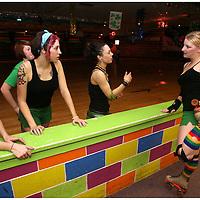 Ashley Talbot, left, Megan Hucks, Becky Durham and Sara Yoder talk before practice at Galaxy Sports in Kinston, N. C.